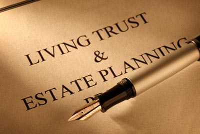 "A paper with a pen on top that read ""living trust & estate planning"""