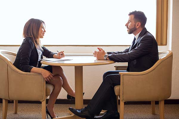 a young female recruiter meeting a male candidate for a business discussion